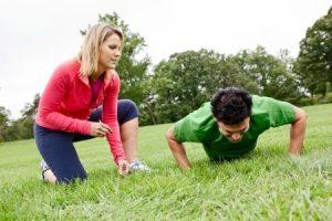 trainer coaching pushups