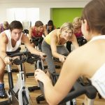 42249408 - group taking part in spinning class in gym