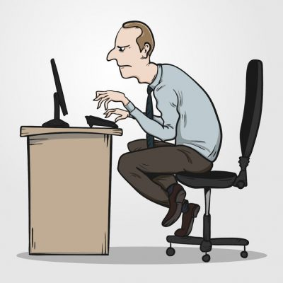 man with bad posture at desk