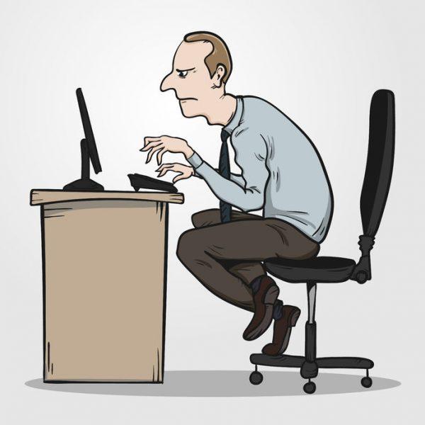 man with bad posture at desk