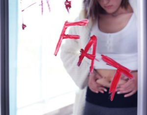 Girl holding her stomach fat