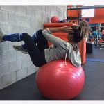 girl supine on stability ball