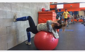 girl prone on exercise ball