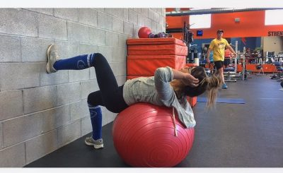 girl supine on exercise ball