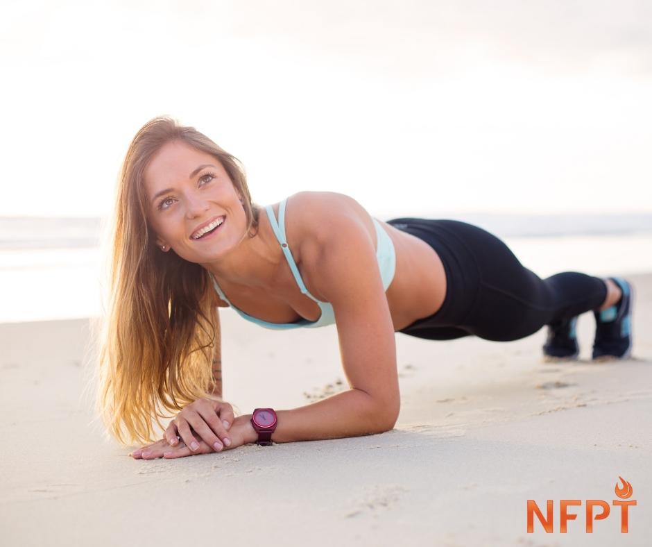 Girl in plank on beach