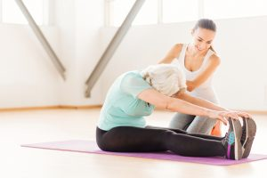 Persistent,Aged,Woman,Doing,Stretching,Exercises