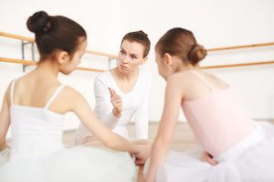 Strict Teacher In Dancing School Talking With Students