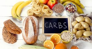 Best Sources Of Carbs On A White Wooden Background