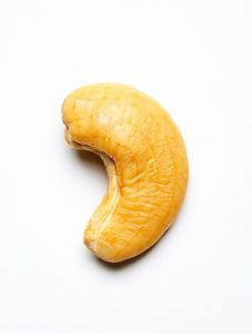 One Cashew Nut Close Up Isolated On A White