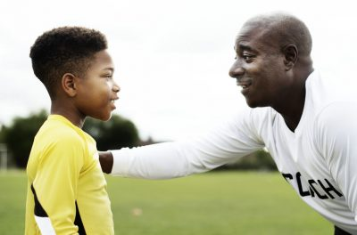 Football Coach Advising The Goalkeeper