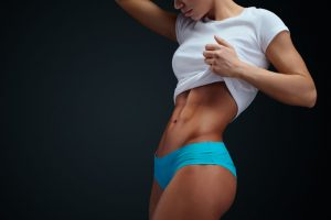 Athletic Woman With Sixpack Abs Posing