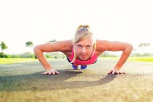 athletic woman doing pushup