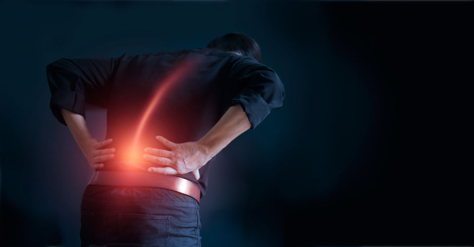 Man Suffering From Back Pain Cause Of Office Syndrome, His Hands